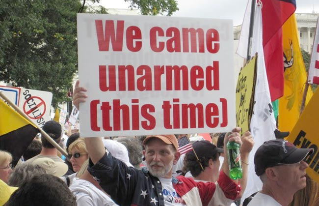 protest sign, we came unarmed this time, rally