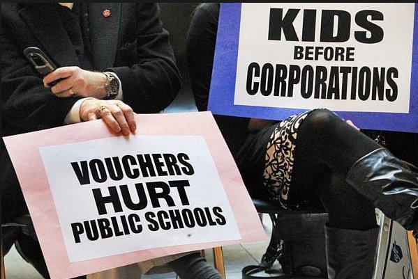 School voucher protest signs