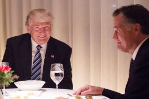 Donald Trump, Mitt Romney, seated at table