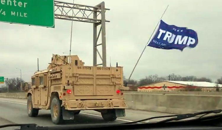 Trump flag on military vehicle, freeway