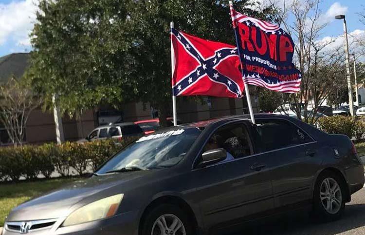 Trump flag, Confederate flag, small car